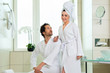 Young couple in bathrobe in hotel bathroom