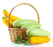 Raw yellow and green zucchini in wicker basket, isolated