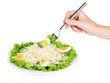 Woman hand with fork and tasty salad, isolated on white