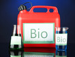 Bio fuels in canister and vials on blue background