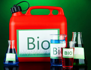 Bio fuels in canister and vials on green  background