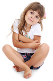 Little girl sitting on floor isolated on white