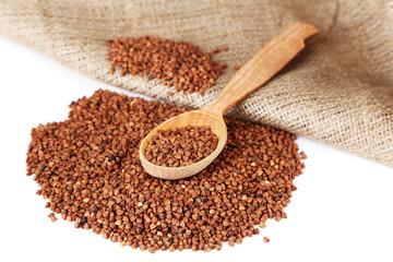 Buckwheat groats and wooden spoon closeup