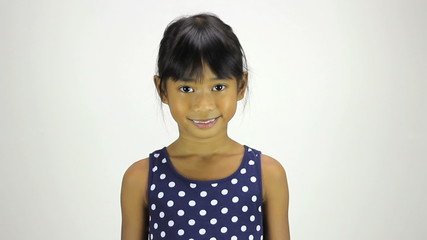 Cute Little Asian Girl Smiling At Camera