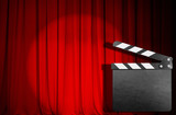 red curtain with empty movie clapper board