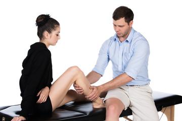 Physiotherapist massaging patient