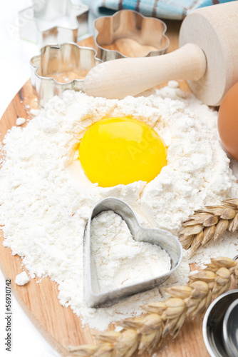 flour, eggs, rolling pin and baking forms, top view