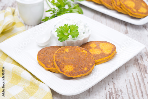 pumpkin fritters with sauce on a plate