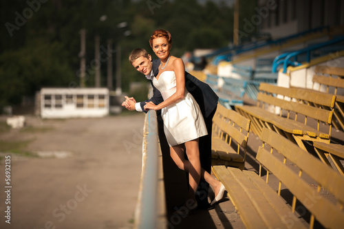 Beautiful couple posing on tribunes