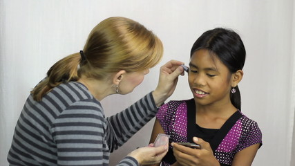 Mother Applies Make Up To Daughter For First Time
