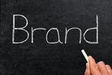 Brand, written on a blackboard.