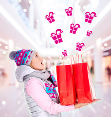 surprised woman with gifts after shopping to the new year