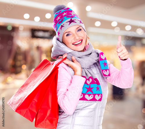 woman with gifts after shopping to the new year at shop