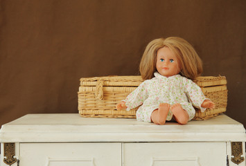 Baby doll siiting on vintage table