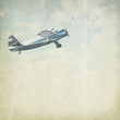 Vintage cloudy background with plane