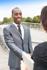Business collaborators handshaking