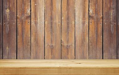 empty shelf on brown wooden plank wall