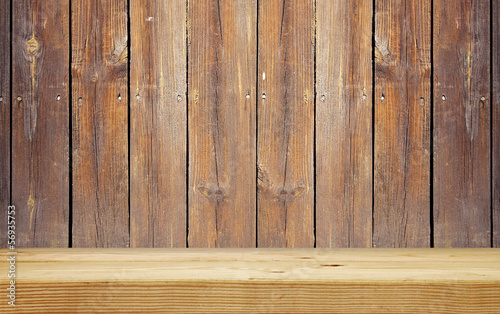 empty shelf on brown wooden plank wall