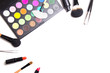 make-up brushes, colorful eyeshadow palette, tweezers and lipsti