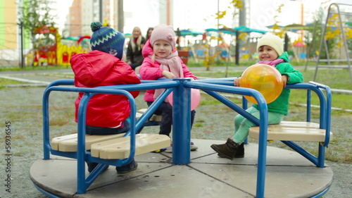 Toddlers having fun on a merry-go-round