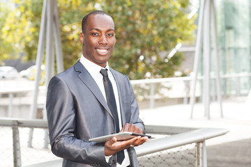 Confident businessman on electronic table