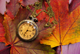Abstract fall background with a pocket watch