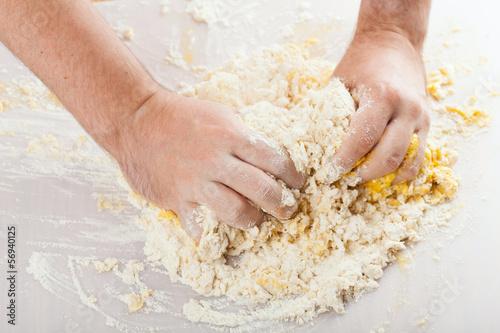 man hands kneading a dough