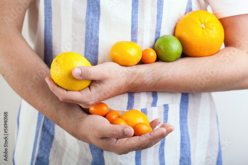 man hands holding citrus fruits