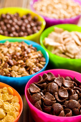 various cereals in colorful bowls