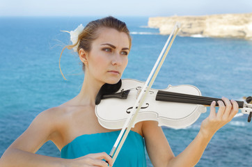 Young beautiful romantic woman with fiddle