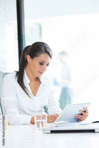 Businesswoman working on her digital tablet
