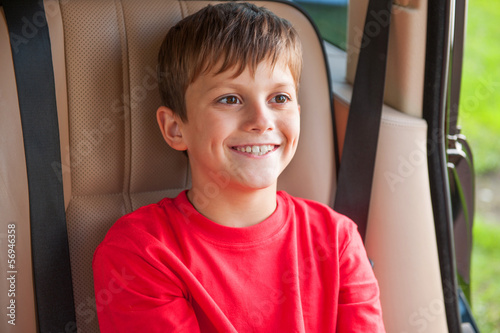 Close-up of a boy face. Big toothy smile, looking forward on a r