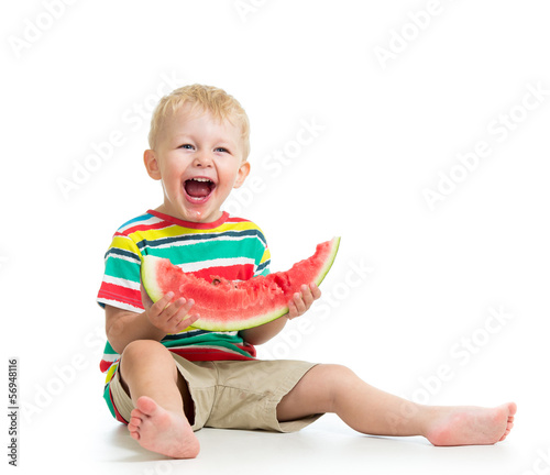 Kid boy eating watermelon isolated on white