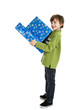 Child holding Christmas presents isolated on white