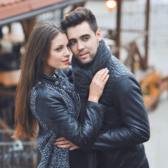 Fashion portrait of young sensual and handsome couple - outdoors