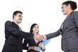 Asian businesspeople handshaking
