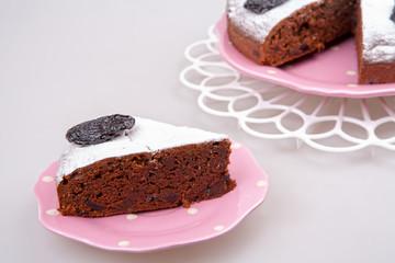 plum dessert with poweder sugar