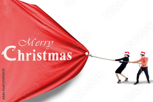 Business team pull christmas banner