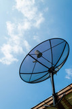 black antenna communication satellite dish over sunny blue sky