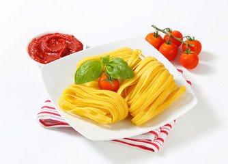 Tagliatelle pasta and tomato paste