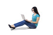 Young woman with laptop sitting on floor