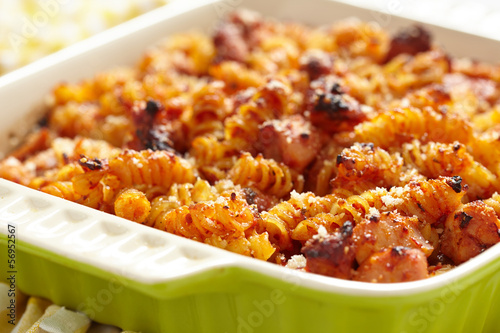 Baked macaroni, chicken, cheese and tomato sauce