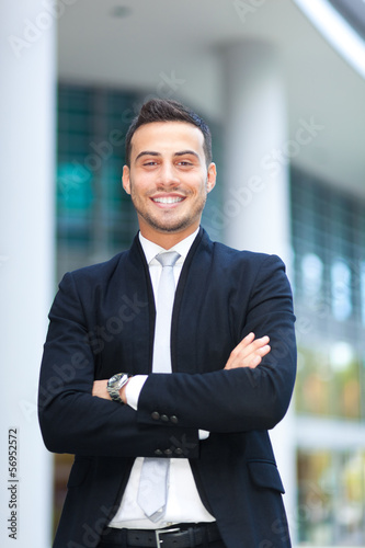 Young businessman portrait in an urban setting