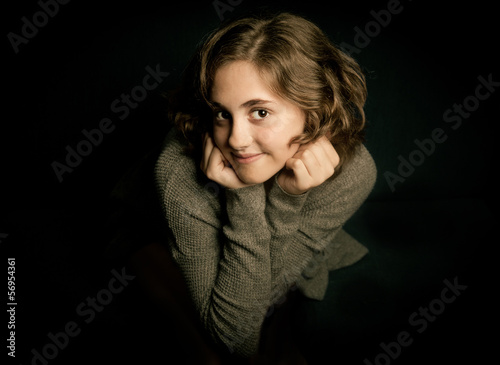 Classic portrait of beautiful girl on black
