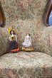 Little dolls in an old armchair color image