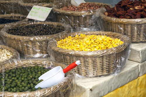 Olives and cereals on a market stall color image