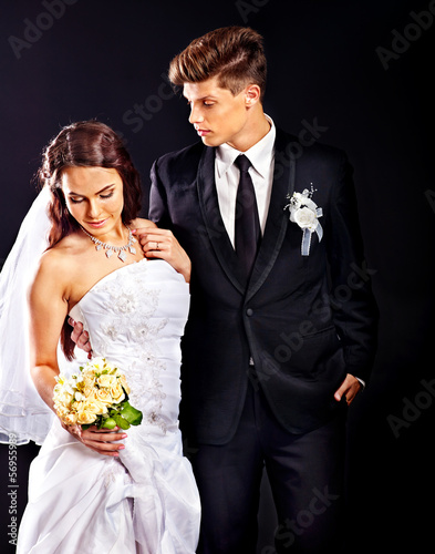 Couple wearing wedding dress and costume.