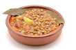 Brown lentil stew in bowl with vegetable