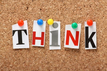 The word Think on a cork notice board