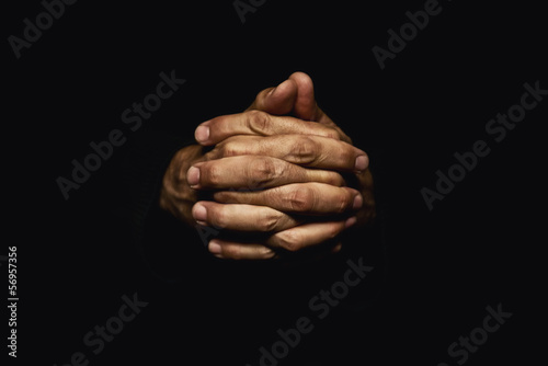 Hands crossed in prayer